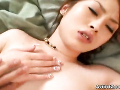 The big fat cock is stretching Asian pussy lips