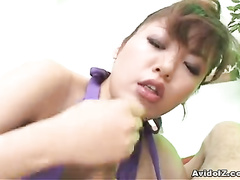 Girl holds dick tightly in her hands and mouth