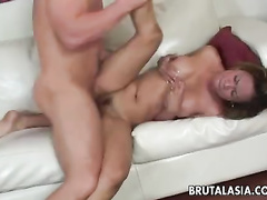 Busty Asian rubs trimmed cunt when fucking
