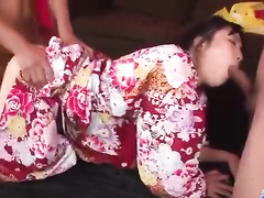 Asian girl in kimono is happy to fuck two dicks