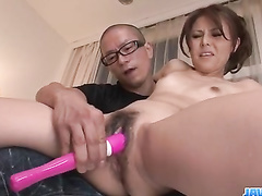 Older man diddling Asian pussy with the vibrator