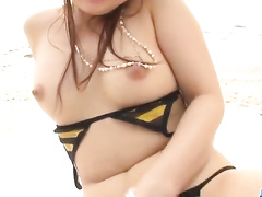 Girl in tiny lingerie is playing with herself