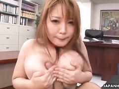 Big-breasted Japanese redhead gives a good titjob