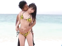 Asian young couple is pleasuring hardcore fuck at the beach