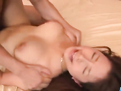 Sexy slender Asian cutie is getting undressed and fucked by two dudes