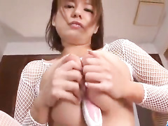 Sweetie Asian babe is hotly posing in white blouse and masturbating her cunt