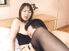 Oriental fucker fondles sexy girlfriend in black stockings