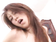 Charming young Japanese chick enjoys threesome fuck