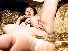 Juicy Asian girl pleasantly masturbates her hairy pussy