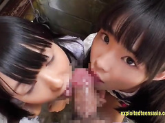 Teen Asian girlfriends Rina and Asami are sucking one dick outdoors