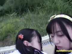 Japanese teen Azuki and her girlfriend are enjoying ffm threesome outdoors