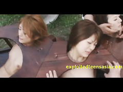 Three Japanese sluts got cuffed in stock and being unsparingly fucked in mouth